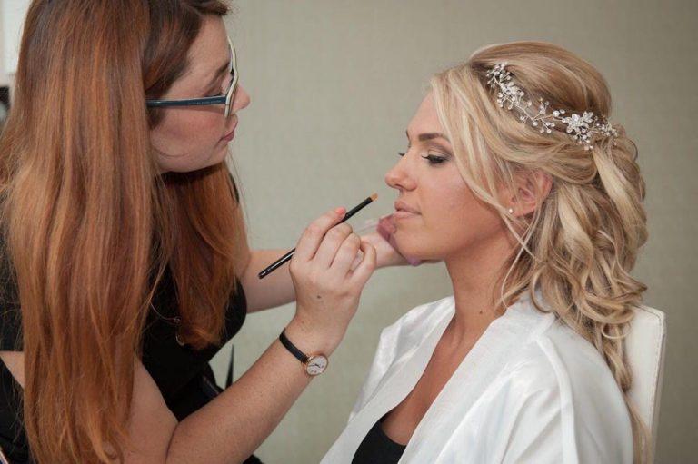 Serena applying lipstick to her bride