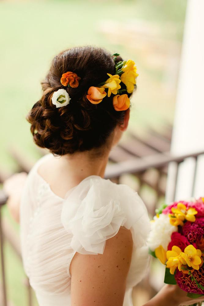 Flowers in hair, yellow , pink and orange