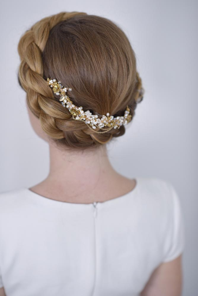 Braid halo up do hairstyle by Storme