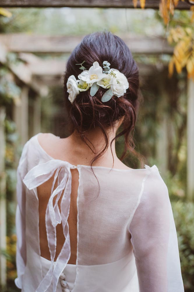 Boho updo with flowers by Storme