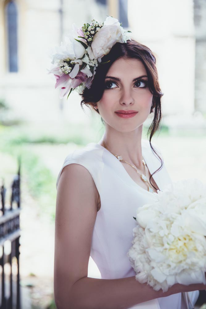 Glamour bride with floral detail, hair and makeup by Storme