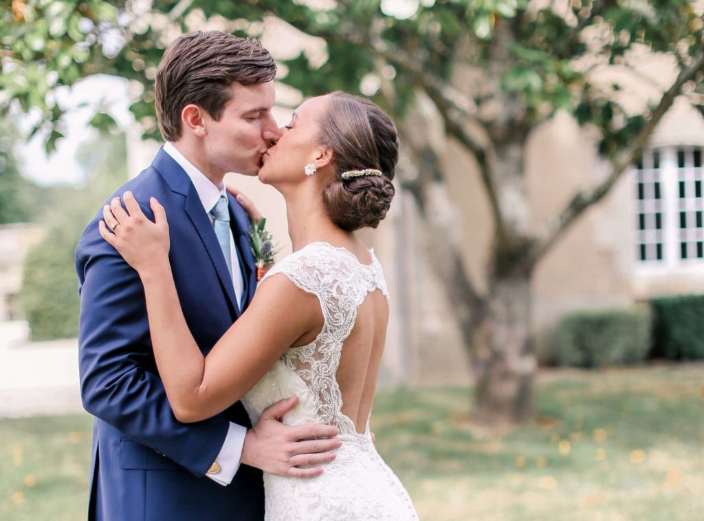 Bride and Groom Kiss Outside - Storme Makeup and Hair Blog