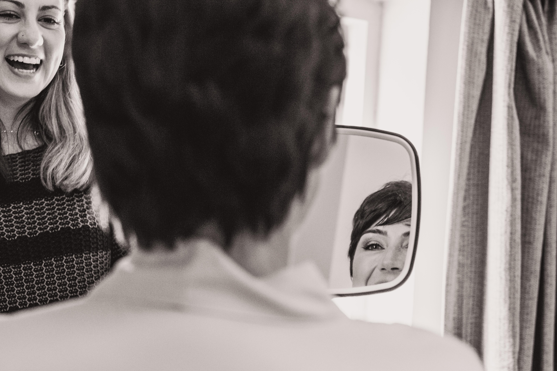 Showing bride her makeup