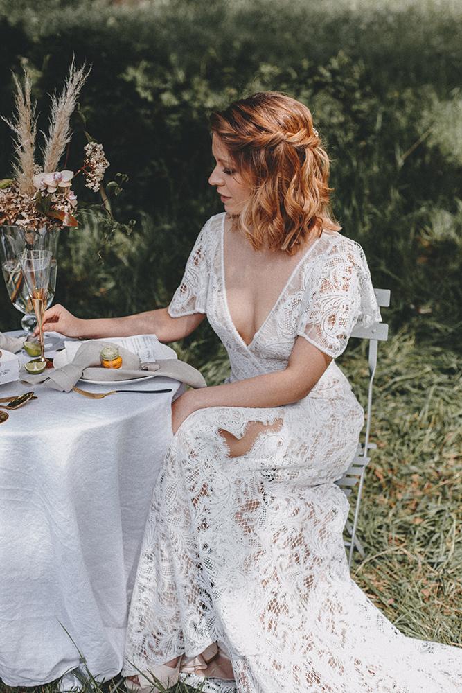 bride at bridal table hair by Jennifer