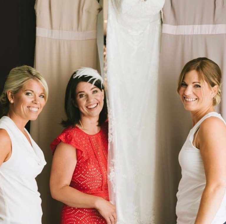 bridal party with dresses, hair and makeup by Charlotte