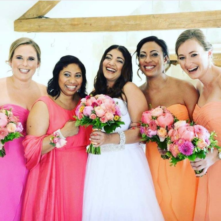 Bright wedding bridal party, hair and makeup by Charlotte