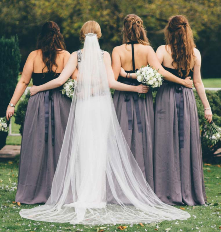 Bridal party with veil, hair by Charlotte