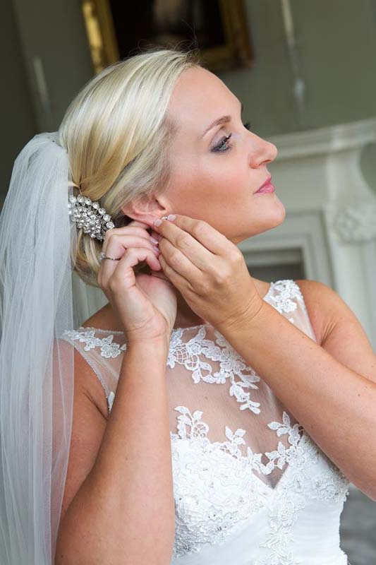 Bride getting ready, hair and makeup by Charlotte