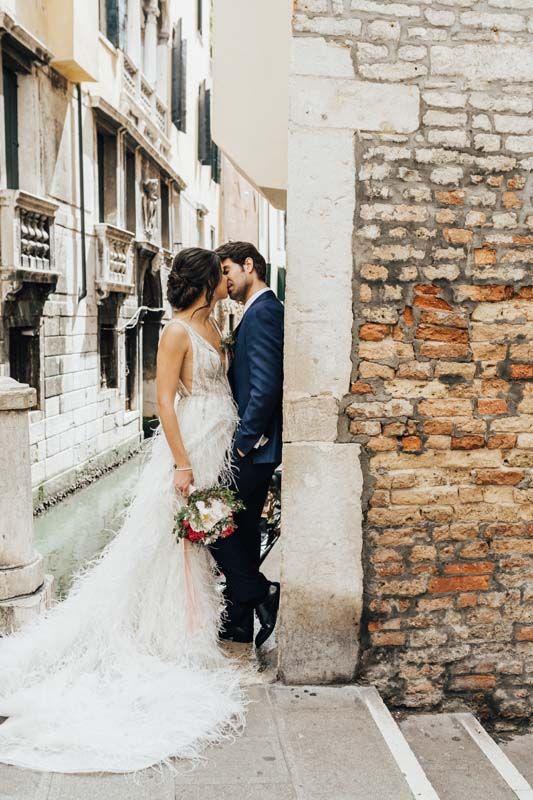 Venice bride and groom kissing, hair and makeup by Storme