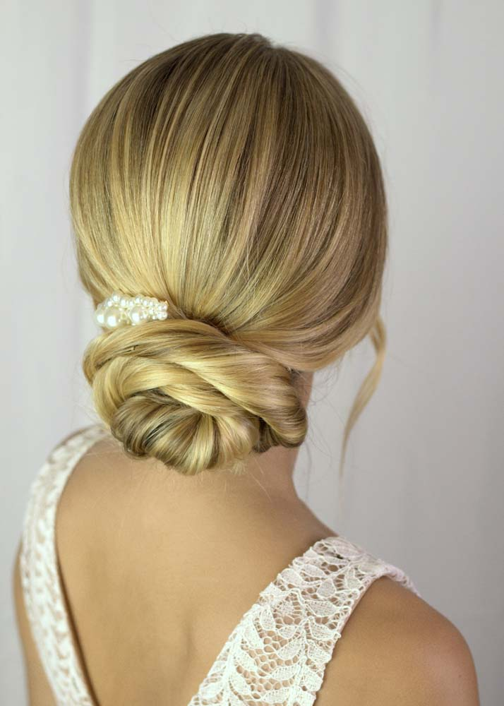 Blonde low bun hairstyle by Storme