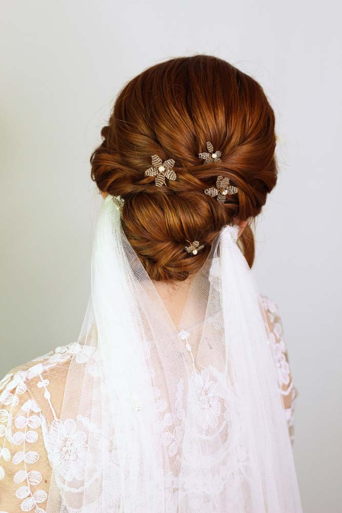 Textured red hair up do with veil, hair by Storme
