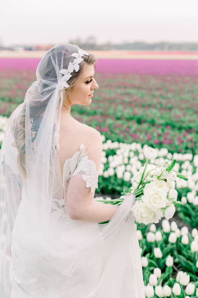 Bride in tulip field, hair and makeup by Jennifer
