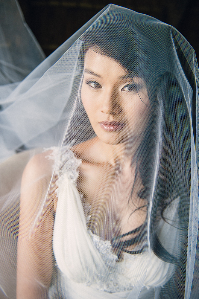 Bride under veil, hair and makeup by Kim