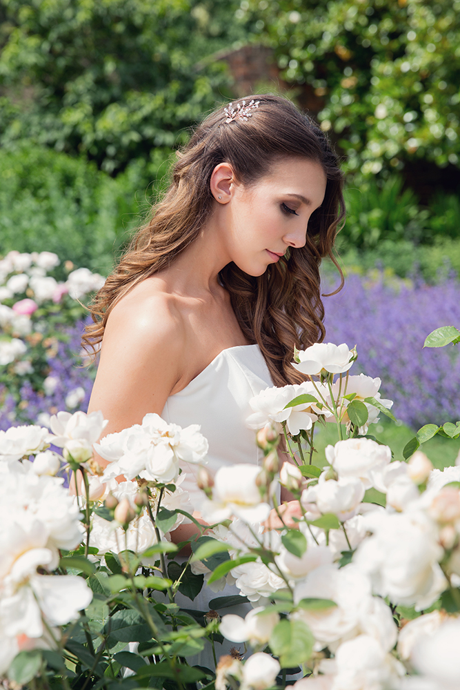 Bride in rose garden, hair and makeup by Kim