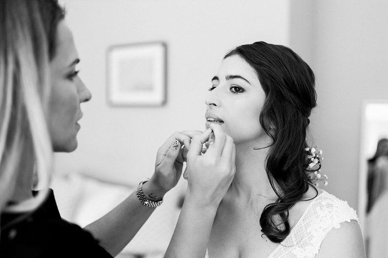 Lucia applying lipstick