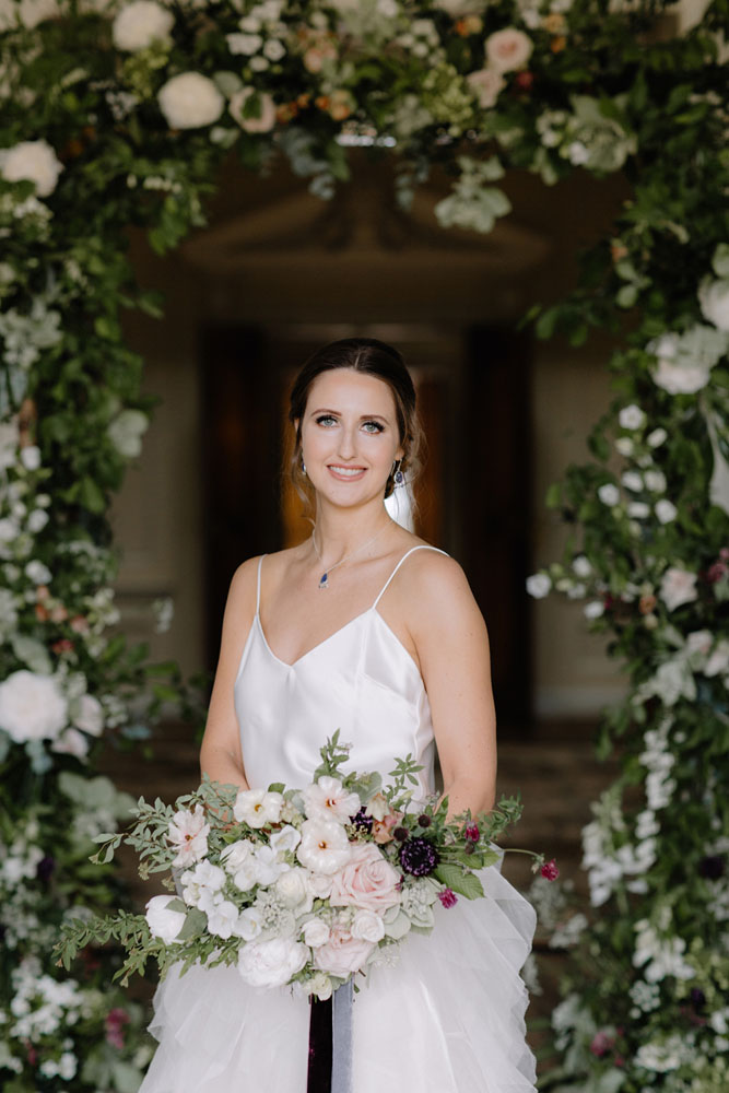 Bride with floral detail, hair and makeup by Alice