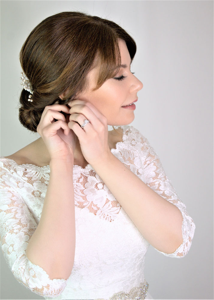 Bride getting ready, hair and makeup by Storme