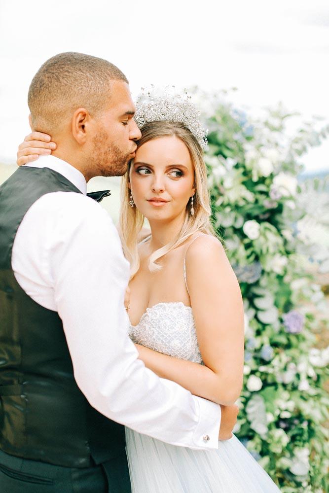 Romantic Wedding Makeup. Groom kissing Bride