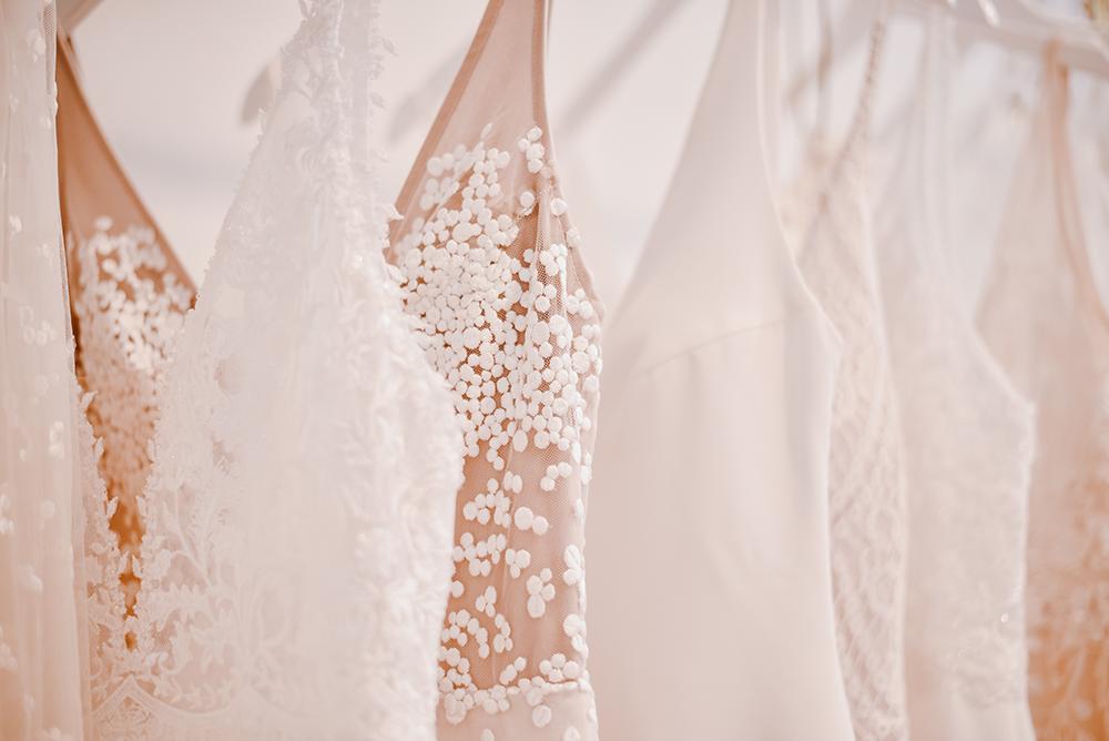 Jessica Bevan Photography - rack of wedding dresses
