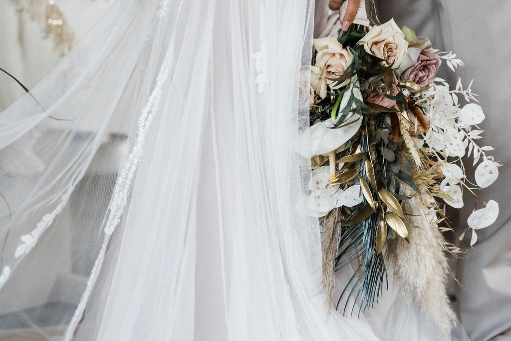 Katie Rogers Photography - wedding dress with boquet