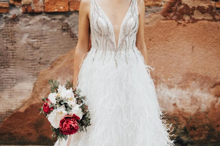 feather wedding dress with bouquet
