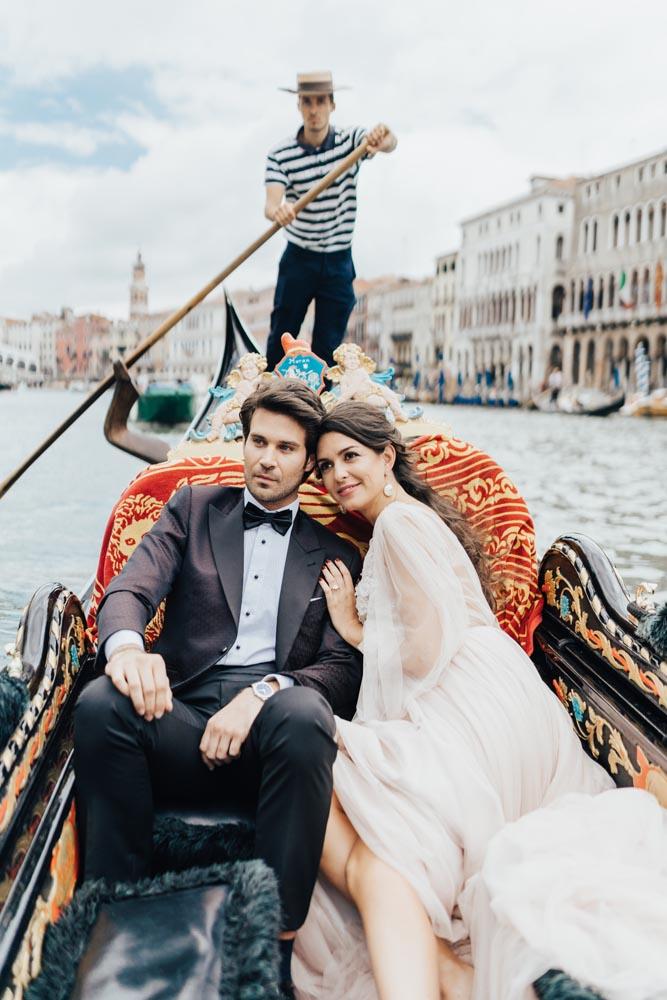 boho wedding bride and groom in gondola