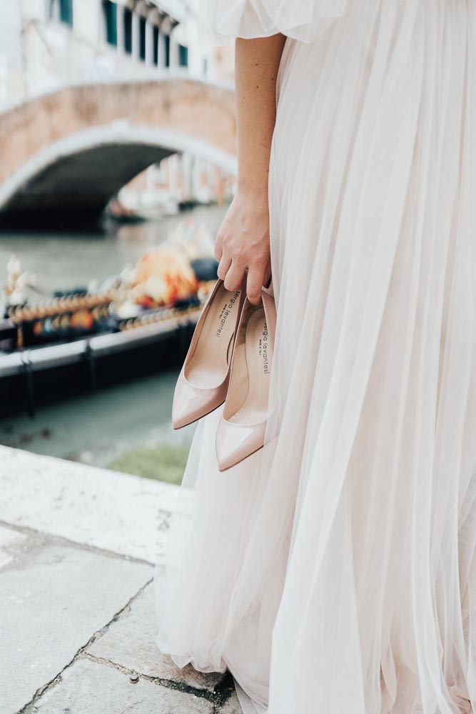 boho bride with shoes in Venice
