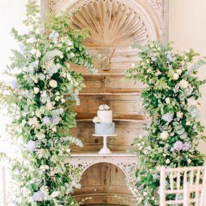 Elegant cake in floral arch