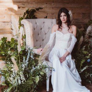 boho bride in floral installation