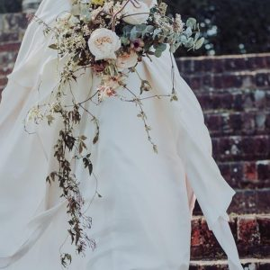 Wild flowers and pink dip dyed wedding dress. Storme Makeup and Hair